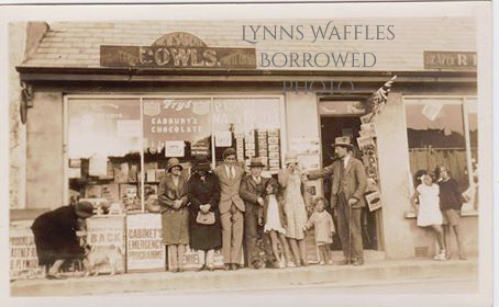 Harry Cowls and his brother Bert Cowls (sons of Harry) with their newsagent shop in Porthleven.