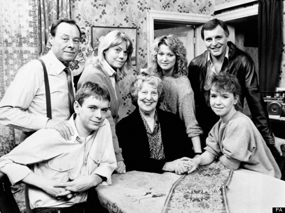 """A 'Family Album' gathering to mark the passing of Lou Beale, matriarch of Albert Square and Britain's favourite television granny, who """"has died peacefully in her sleep"""" so that actress Anna Wing couldwithdraw from the cast of the BBC-1 top-rated serial to work on other projects. Lou is seated with Ian (Adam Woodyatt) and Michelle (Susan Tully). Standing are, from left: Arthur (played by Bill Treacher); Pauline (played by Wendy Richard), Kathy (played by Gillian Taylforth) and Pete (played by Peter Dean)"""