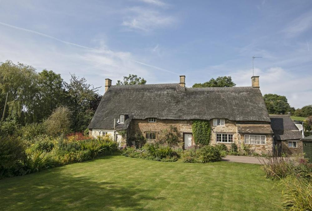 The Old Forge. GRADE 11 LISTED STONE AND PRINCIPALLY THATCHED VILLAGE HOUSE